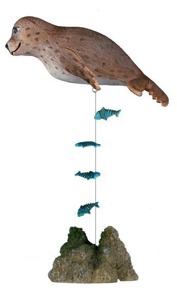 Декорация в аквариум - Тюлень с рыбками 12см